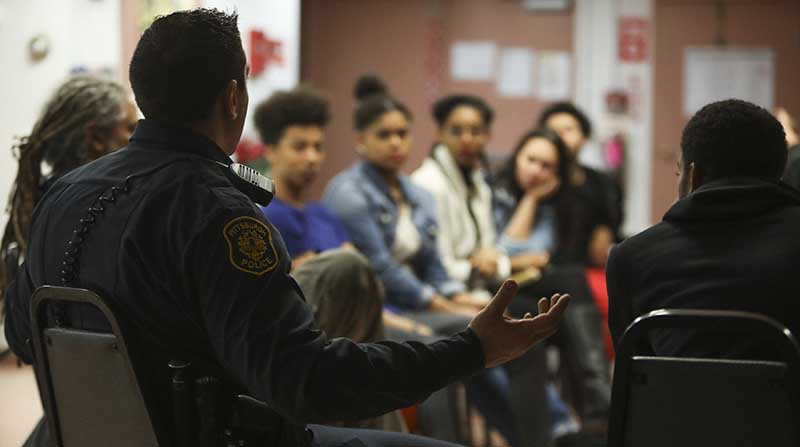 Pittsburgh police officers talk with Pittsburgh-area teenagers about how they can maintain peace and mutual respect during their interactions.