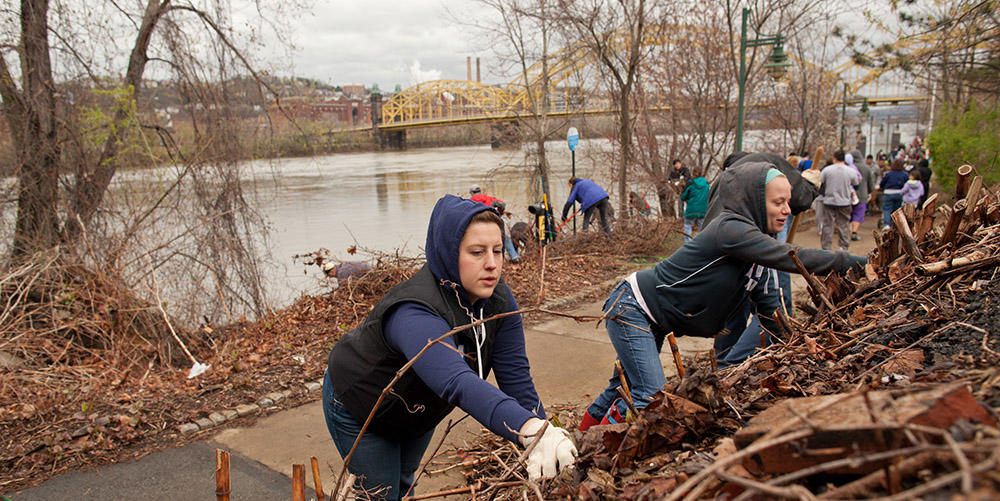 Friends of the Riverfront leads hundreds of volunteers to clean the riverbanks in Pittsburgh.