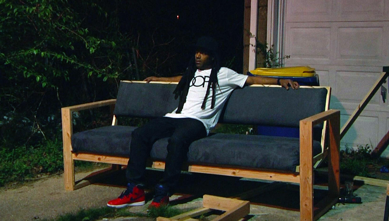 """Post Bauhaus: Fly Sneakers & a Dope Sofa,"" video still, by JSTN CLMN. The artist was among the 12 who received Investing in Professional Artists funding in 2017. He is developing a new body of ceramic work documenting historic sites and buildings of Black Pittsburgh on the faces of ceramic plates, as well as an exhibition and a related catalog with the goal of loaning the objects to community institutions for exhibition."