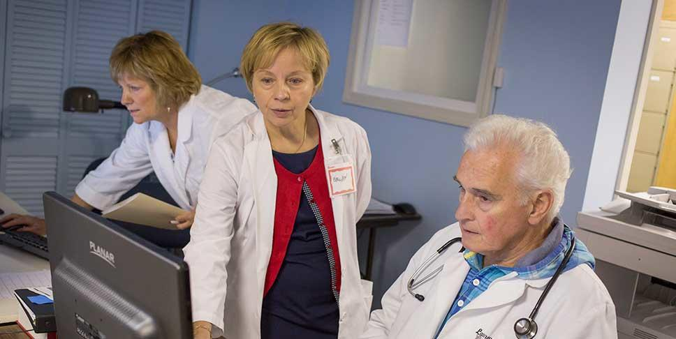 A $9,000 grant from the Community Foundation of Westmoreland County enabled Majesty Health Care Clinic, an all-volunteer organization that recently opened in Greensburg, to invest in new computers and a fluid database. Here,  Dr. Larry Lyons and Ellie Yearsley, RN, discuss treatment options.