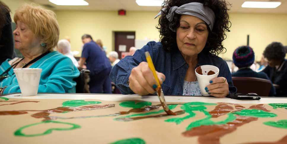 Rose Marie Harris, right, paints leaves on a mural at Community Life of McKeesport through the nonprofit Fine Art Miracles, Inc, which was founded by Tess Lojacono to bring fine art to nursing homes and assisted living facilities. In 2012, Lojacono was awarded $100,000 as part of the Expereinced Dreamers contest to raise awareness of the region as a great place to live, work and realize your dreams, regardless of age.