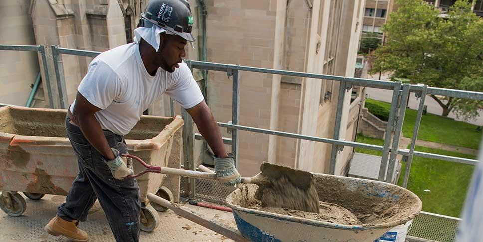 Meaningful employment is a key component of healthy communities. Here, Marcus Kelley, a graduate of the Trade Institute, works at a job site in Oakland.